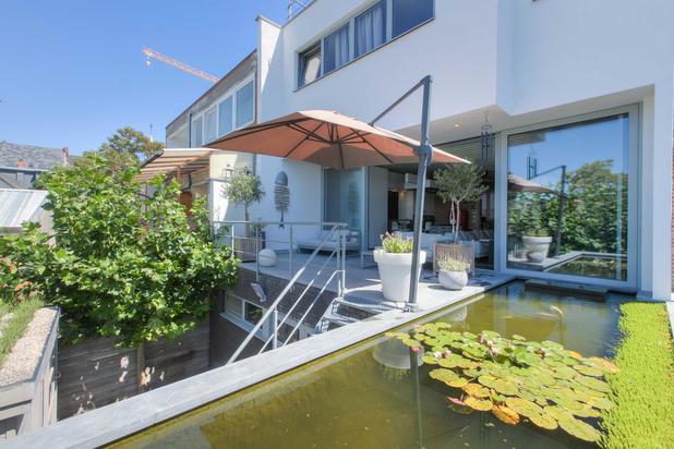 Trendy herenwoning in loftstijl met prachtige terrassen